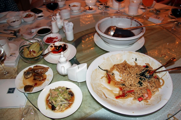 A beggar's delight: Despite being transferred to smaller plates, this was the amount of unfinished food after an eight-course Chinese wedding dinner at Sheraton Towers (Source: Food Waste Republic)
